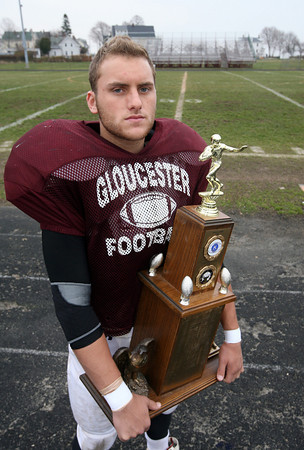 Gloucester: Gloucester senior captain Chris Unis holds the Thanksgiving Trophy, which the Fishermen have had since 2005. Photo by Kate Glass/Gloucester Daily Times
