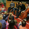 Manchester: First and second grade students listen to celloist Paul Wiancko as the members of the Harlem Quartet speak about their music career at the Brookwood School Thursday morning. The quartet came and performed for the school as a part of the Cultural Enrichment programming. Mary Muckenhoupt/Gloucester Daily Times