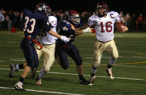 Sudbury: Gloucester's Gilbert Brown dodges Lincoln Sudbury's Chris Georgio during the Division 1A semi-final at Lincoln Sudbury Regional High School last night. Photo by Kate Glass/Gloucester Daily Times