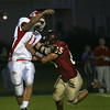 Gloucester: Gloucester's Chris Burke goes after Masconomet quarterback Ben Panunzio during their game at Newell Stadium earlier this year. Photo by Kate Glass/Gloucester Daily Times