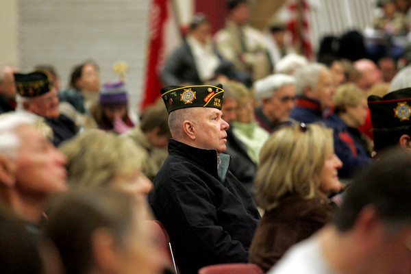 Gloucester: Edwin Leavitt, who served in the Navy during the Cuban Missile Crisis, listens to speaker Sgt. Dorothy Martins, Korean War Veteran, during the Veterans Day Ceremony held at Gloucester High School Thursday morning.  The ceremony was followed by a parade to American Legion Square for a World War 1 Ceremony. Mary Muckenhoupt/Gloucester Daily Times