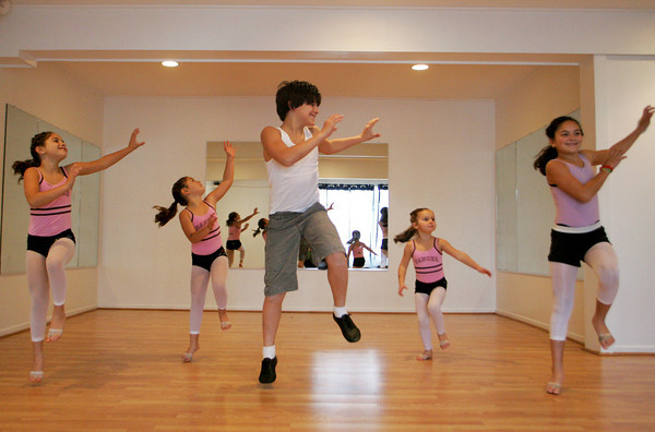 """Gloucester: Joseph Billante, 12, rehearses with his sister's Zariah, 9, Matina, 7, Daunika, 5, and Aurora, 10, for Wednesday night's event at Cruisport called """"Cape Ann's Got Talent"""" to raise money for Cape Ann Families at Dawn's Studio of Dance Thursday afternoon. Mary Muckenhoupt/Gloucestr Daily Times"""