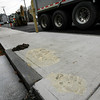 Essex: Essex Police have charged seven juveniles with defacing a sidewalk in front of Cunha-St. John Antiques. Handprints and initials were printed into the concrete while it dried. Photo by Kate Glass/Gloucester Daily Times