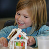 Rockport: Lily Christopher, 5, of Rockport, smiles as she shows her graham cracker gingerbread house to her mother at the Rockport PTO Holiday Fair at Rockport High School Saturday afternoon. Mary Muckenhoupt/Gloucester Daily Times