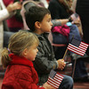 Gloucester: Noah Willett, 5, and his friend Annika Nyborg, 5, sit and watch the Gloucester High School ROTC program perform during the Veterans Day Ceremony held at Gloucester High School Thursday morning.  The ceremony was followed by a parade to American Legion Square for a World War 1 Ceremony. Mary Muckenhoupt/Gloucester Daily Times