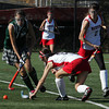 Manchester Essex's Kyle Marsh moves the ball past Watertown's Kaylee McNamara during the North Sectional Division II Championship field hockey tournament at North Andover High School Saturday. Watertown defeated Manchester Essex 2-1. Mary Muckenhoupt/Gloucester Daily Times