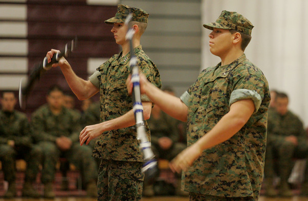 Gloucester: Cadet Capt. Aaron Dahlmer, left, and 2nd Lt. Jonathan Moulton of Gloucester High School's armed drill team performs a drill during the Gloucester Veterans Day Ceremony held at Gloucester High School Thursday morning. The ceremony was followed by a parade to American Legion Square where where a World War I ceremony was held. Mary Muckenhoupt/Gloucester Daily Times