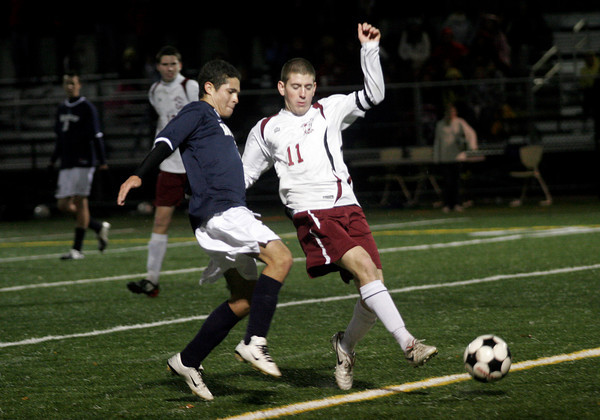 Manchester: Rockport's Andrew Visnick gets past Winthrop's Rigen Mehilli during their playoff matchup at Hyland Field in Manchester yesterday. The Vikings won 5-1. Photo by Kate Glass/Gloucester Daily Times