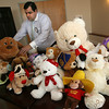 Gloucester: Eric Noble places a large stuffed dog with other stuffed animals collected by Rotarians during their weekly lunch at Cruiseport on Tuesday. The animals will be donated to Pathways for Children. Photo by Kate Glass/Gloucester Daily Times