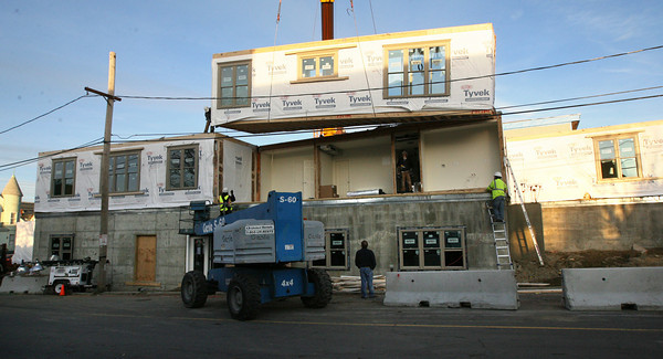 Gloucester: Workers set a modular piece into place on the site of the Lorraine building, which burned to the ground in 2007. Photo by Kate Glass/Gloucester Daily Times