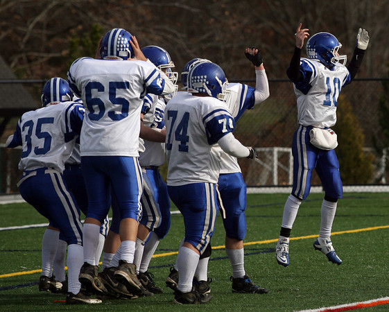 Manchester: Georgetown quarterback Tyler Wade leaps in the air as the clock runs out, giving them a 10-0 win over Manchester Essex during yesterday's Thanksgiving Day Game at Hyland Field. Photo by Kate Glass/Gloucester Daily Times