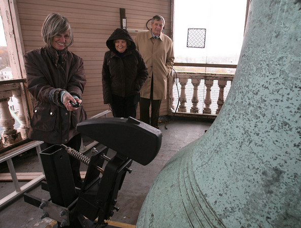 Gloucester: Maggie Rosa, Chair of the City Hall Restoration Commission, attempts to ring the bell at City Hall using a remote control as Jan Bell and Steve Dexter look on. The commission will be ringing the bell on Veterans Day at 11:11 to honor those who served in the armed forces. Photo by Kate Glass/Gloucester Daily Times