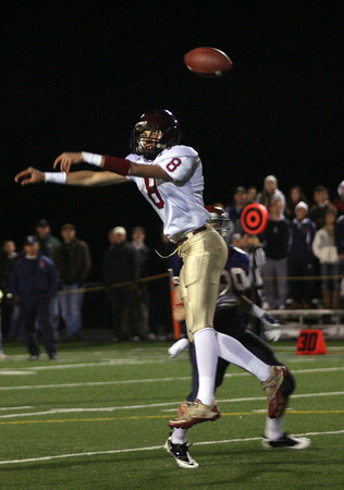 Sudbury: Gloucester's Mike Tomaino nearly intercepts a pass thrown by Lincoln Sudbury's Matt Cahill during the Division 1A semi-final at Lincoln Sudbury Regional High School last night. Photo by Kate Glass/Gloucester Daily Times