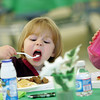 Manchester: Norah Jewett, 3, enjoys her breakfast at the Green and White pancake breakfast sponsored by the Manchester-Essex Rotary Club at the Manchester Essex Regional High School Saturday morning.  This was the 6th Annual Green & White Breakfast, which recognizes all MERHS students who serve in leadership roles with proceeds benefiting the Rotary Club Scholarship Fund. Mary Muckenhoupt/Gloucester Daily Times<br /> .
