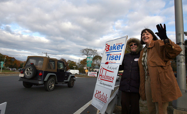 Gloucester: Janet Holmes, Republican candidate for State Representative, right, and supporter Marlene Hodgkins stand at Grant Circle yesterday evening. Polls are open until 8 p.m. tonight. Photo by Kate Glass/Gloucester Daily Times