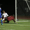 Weymouth: Rockport's Shaffy Roell watches as his shot gets by Dover-Sherborn goalie Brian Hands in the state semi-finals at Weymouth High School last night. Photo by Kate Glass/Gloucester Daily Times