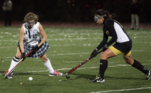 Manchester Essex's Olivia Dumont keeps the ball away from Bishop Fenwick's Erin Botticelli during the MIAA Division 2 North Semi Finals last night. Photo by Kate Glass/Gloucester Daily Times