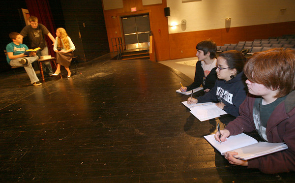 """Gloucester: From right: Jeremiah Burke, Fiona Prentice, and Marika Gillis, all juniors at Gloucester High School, watch as their classmates rehearse a scene from """"It Was a Dark and Stormy Night,"""" which they wrote. The play is an adaptation of the board game, Clue, and will be performed December 3-4 at 7pm and December 5 at 2 pm in the high school auditorium. Photo by Kate Glass/Gloucester Daily Times"""