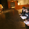 "Gloucester: From right: Jeremiah Burke, Fiona Prentice, and Marika Gillis, all juniors at Gloucester High School, watch as their classmates rehearse a scene from ""It Was a Dark and Stormy Night,"" which they wrote. The play is an adaptation of the board game, Clue, and will be performed December 3-4 at 7pm and December 5 at 2 pm in the high school auditorium. Photo by Kate Glass/Gloucester Daily Times"