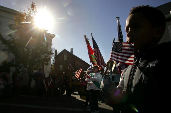 Gloucester: Jisaiah Barani, 6, holds an American flag while standing with his friends at the Gloucester Veterans Day Ceremony in front of the American Leagion Thursday morning. Mary Muckenhoupt/Gloucester Daily Times