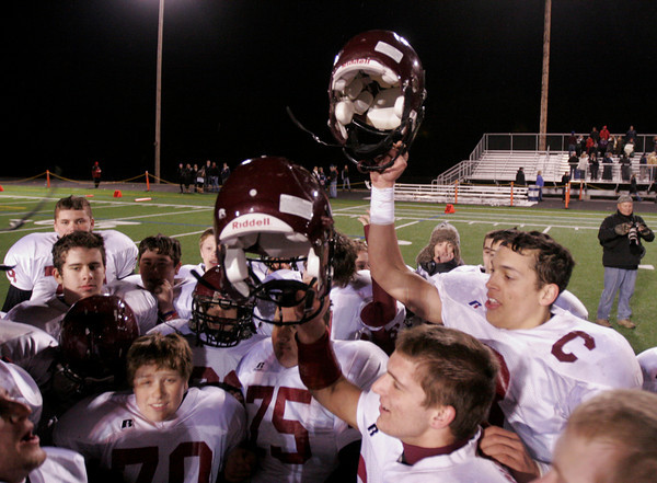 Sudbury: Gloucester's Mike Tomaino and Brandon Cusumano raise their helmets as they celebrate their 21-0 win over Lincoln Sudbury during the Division 1A semi-final at Lincoln Sudbury Regional High School last night. Photo by Kate Glass/Gloucester Daily Times