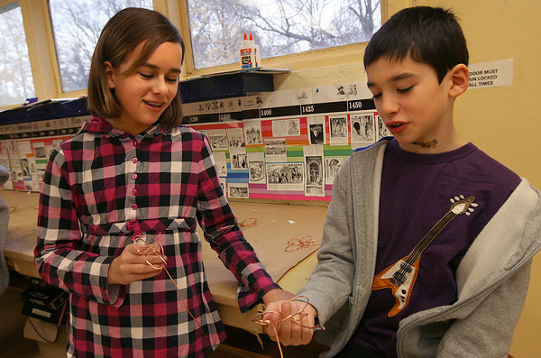 "Essex: Olivia Provost and Atticus Takayesu help each other while making butterflies from copper wire during art class at Essex Elementary School. Butterflies made by the fourth graders will be assembled into a large sculpture by Chris Williams and auctioned off in the PTO online auction, which begins Wednesday at  <a href=""http://www.essexpto.com"">http://www.essexpto.com</a>. Photo by Kate Glass/Gloucester Daily Times"