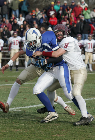 Danvers: Danvers' Patrick McBride gets tackled by Gloucester's Ben Chianciola during the Thanksgiving Day football game at Derring Stadium Thursday morning. Gloucester defeated Danvers 43-0. Mary Muckenhoupt/Gloucester Daily Times