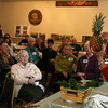 "Rockport: Robin Murphy describes how to dry a pineapple for use in floral arrangements during the Rockport Garden Club's annual meeting at Scout Hall yesterday afternoon. Murphy's presentation was themed ""Home for the Holidays."" Photo by Kate Glass/Gloucester Daily Times"