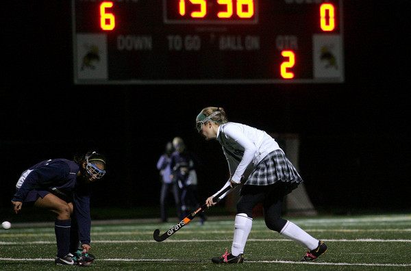 Manchester: Manchester Essex's Piper Brown sends the ball past Swampscott's Gabriella Wooten during the Division 2 North first round field hockey tournament held at Hyland Field Wednesday night. Manchester Essex defeated Swampscott 7-0. Mary Muckenhoupt/Gloucester Daily Times