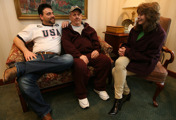 Gloucester: Vito Loiacono and his grandfather, Joseph Judd, chat with Peggy Rose, a case manager for SeniorCare who was fired for conducting her own investigation into allegations of neglectful care of Judd. Photo by Kate Glass/Gloucester Daily Times