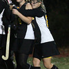Reading: Bishop Fenwick's Meg Delory comforts teammate Jennifer Jordan following their 4-0 loss to Manchester Essex in the MIAA Division 2 North Semi Final at Reading Memorial High School last night. Photo by Kate Glass/Salem News