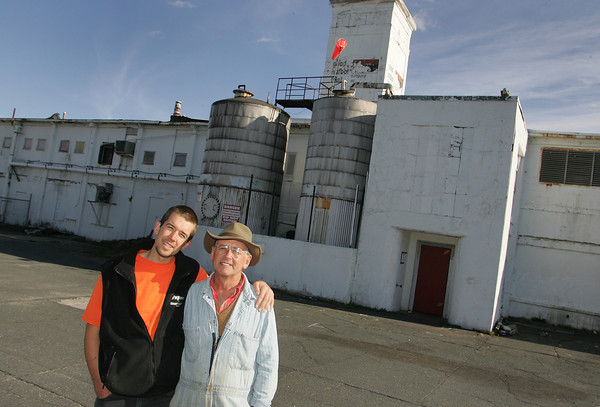 Gloucester: Mac Bell and his son Temba (richard checking spellling) stand in front of the old Birdseye property that Bell has targeted for redevelopment. Mary Muckenhoupt/Gloucester Daily Times