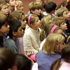 Manchester: First and second grade students, including Grace Perryman, center, listen to members of the Harlem Quartet speak about their music career at the Brookwood School Thursday morning. The quartet came and performed for the school as a part of the Cultural Enrichment programming.<br /> Mary Muckenhoupt/Gloucester Daily Times