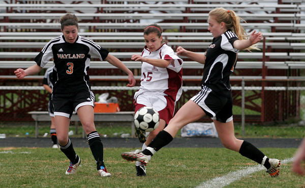 Gloucester: Gloucester captain Stephanie Kelley gets the ball by Wayland's Allie Wurfel and Emily Nuss during the first round of the MIAA Division 2 North Championship on Saturday. Photo by Kate Glass/Gloucester Daily Times