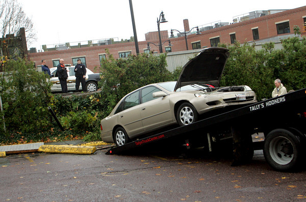 Gloucester: Gloucester police are speculating driver error for a Toyota Camry that went through a fence between Bank Gloucester and Sovereign Bank as seen from Middle Street Friday. Mary Muckenhoupt/Gloucester Daily Times