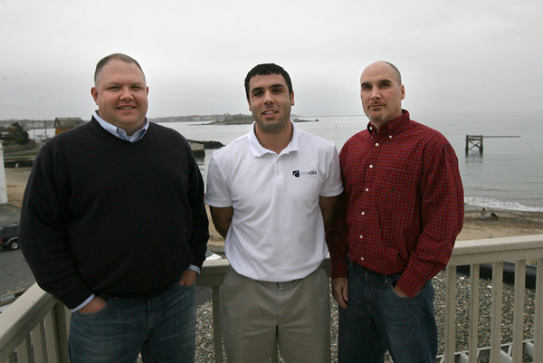 Neil Costa, founder of HireClix.com, stands with employees Tony Testaverde and Scott Ryan outside their Gloucester office. Photo by Kate Glass/Gloucester Daily Times
