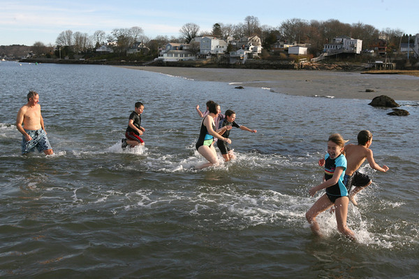 """Gloucester: Rina Sutherland, 9, screams """"I'm going to die"""" as she races through the chilly waters off Wheeler's Point during the 22nd Annual Thanksgiving Morning Swim yesterday. Photo by Kate Glass/Gloucester Daily Times"""