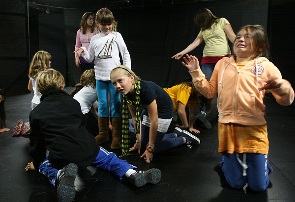 """Gloucester: Brianna Ward, right, and Lily Armstrong crawl around Sara Wheeler during the last class of the Gloucester Stage Youth Acting Workshop on Saturday while doing an improv skit in preparation for their show """"Holiday Delights,"""" which will be performed in December. Photo by Kate Glass/Gloucester Daily Times"""