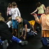 "Gloucester: Brianna Ward, right, and Lily Armstrong crawl around Sara Wheeler during the last class of the Gloucester Stage Youth Acting Workshop on Saturday while doing an improv skit in preparation for their show ""Holiday Delights,"" which will be performed in December. Photo by Kate Glass/Gloucester Daily Times"