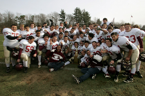 Danvers: The Fisherman pose for a team picture with their Kiwanis trophy after defeating Danvers 43-0 in the Thanksgiving Day football game at Deering Stadium Thursday. Mary Muckenhoupt/Gloucester Daily Times