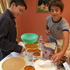 Gloucester: BJ Mohan of Gloucester and Gabriel Reynolds of Peabody measure out ingredients for pumpkin pie as they and their 7th grade classmates from Saint Mary of the Annunciation School in Danvers bake 40 pies for My Brother's Table in Lynn. Photo by Kate Glass/Gloucester Daily Times