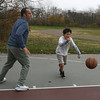 Rockport: Joe Muzio of Rockport plays basketball with his uncle, Matt Muzio, on the outdoor basketball court at Rockport High School Tuesday afternoon. Matt is visiting from California. Photo by Kate Glass/Gloucester Daily Times