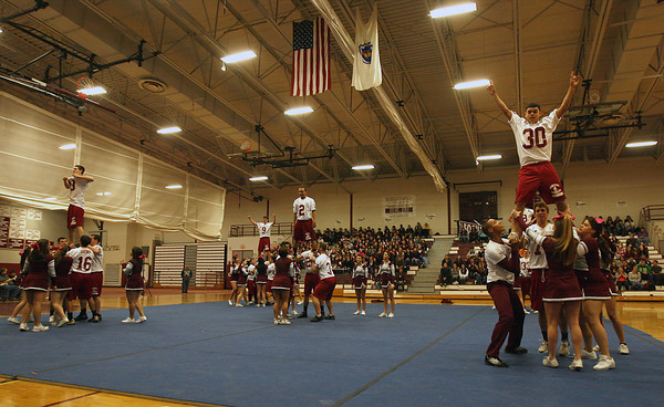 Gloucester: Matt Catarino, right, raises his arms while being hoisted by teammate Andrew Mizzoni and the Gloucester High School cheerleaders during a pep rally at the Benjamin A. Smith Fieldhouse yesterday morning. Photo by Kate Glass/Gloucester Daily Times