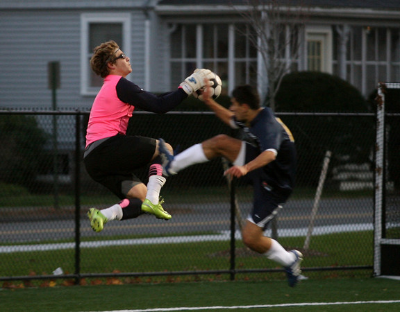 Keady Segel leaps to get the ball away from Lynnfield's Marco Addonizio during the MIAA Division 3 North Quarter Finals at Hyland Field last night. Photo by Kate Glass/Gloucester Daily Times