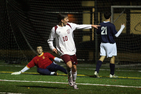 Manchester: Rockport's Shaffy Roell points to teammate Luke Catena (not shown) who got the assist on Roell's goal during their playoff matchup against Winthrop at Hyland Field in Manchester yesterday. The Vikings won 5-1. Photo by Kate Glass/Gloucester Daily Times