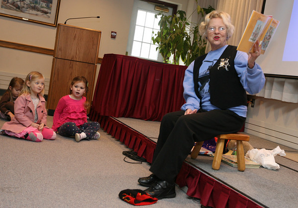 Rockport: Laurel Brau and Charlotte Mento listen as Betty Erkkila reads stories about Thanksgiving during story hour at the Rockport Public Library yesterday morning. Photo by Kate Glass/Gloucester Daily Times