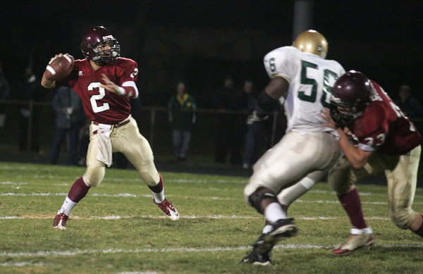 Gloucester: Gloucester's Joseph Avila looks for an open receiver during the first half of the Gloucester vs. Lynn Classical at Newell Stadium Friday night. Mary Muckenhoupt/Gloucester Daily Times