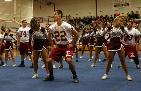 Gloucester: Adam Philpott shows off his dance moves as seniors on the football team perform a routine with the Gloucester High School cheerleaders during a pep rally at the Benjamin A. Smith Fieldhouse yesterday morning. Photo by Kate Glass/Gloucester Daily Times