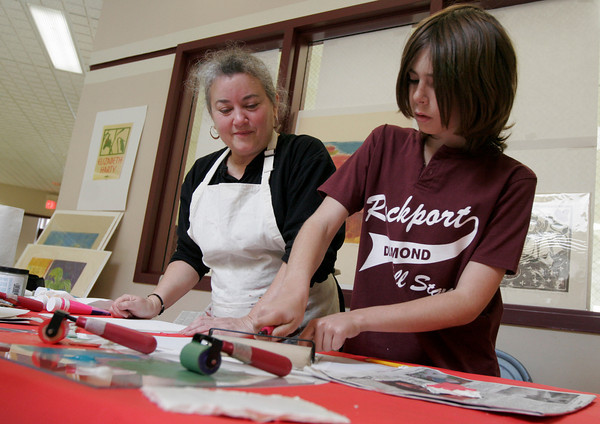 Rockport: Elizabeth Harty, a member of the Rockport Art Association, helps  Jackson Higgins, a fourth grade student at Rockport Elementary School, during her printmaking demonstration at the school yesterday. The demonstration was part of the RAA's artist-in-residence program. Photo by Kate Glass/Gloucester Daily Times