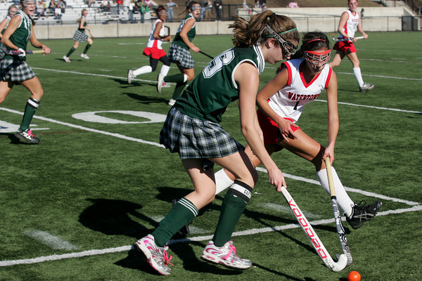 Manchester: Manchester Essex's Olivia Dumont fights for possession of the ball with Watertown's Jessica Doggett during the North Sectional Division II Championship field hockey tournament at North Andover High School Saturday. Watertown defeated Manchester Essex 2-1. Mary Muckenhoupt/Gloucester Daily Times